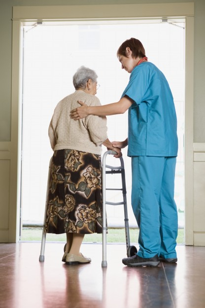 Elderly woman and care provider