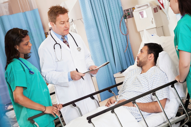 Clinicians with patient at bedside